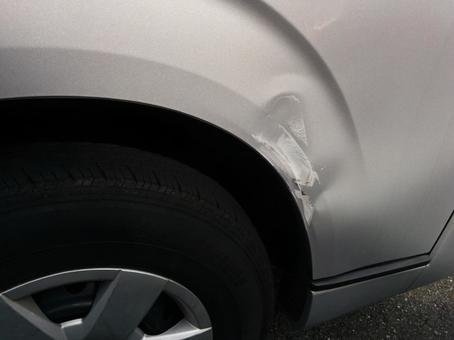 Dent around tire 1