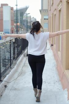 Woman walking by spreading both hands 2