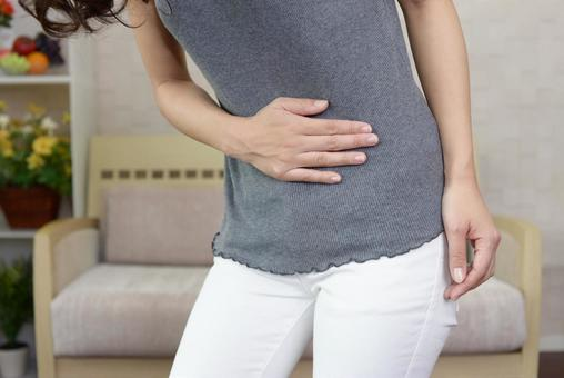 Woman complaining of abdominal pain
