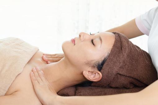 A woman undergoing treatment at an esthetic salon