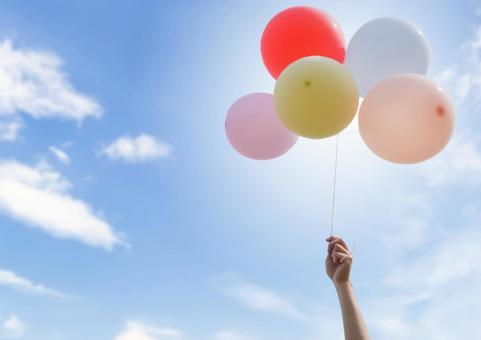Sky and balloons on hand
