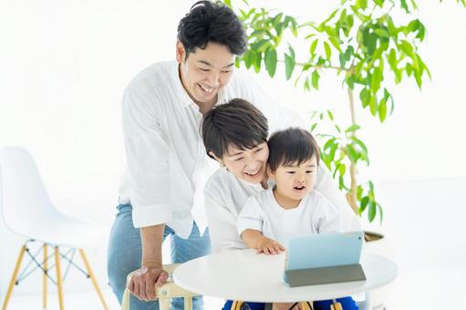 Parents and children communicating online using a tablet PC