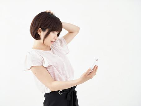 A woman who operates a smartphone with a face that came