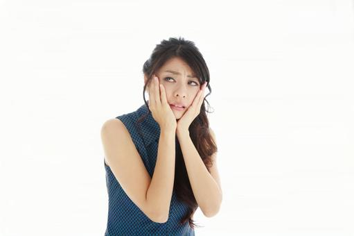 Japanese women suffering from toothache
