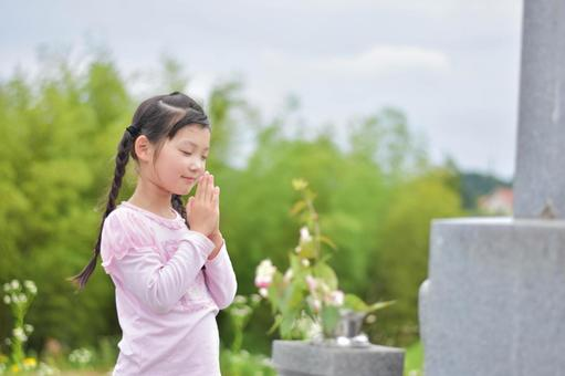 A child visiting a grave