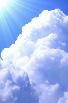 Summer sky and sun with cumulonimbus clouds