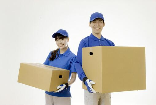 Male and female moving workers with cardboard boxes 2