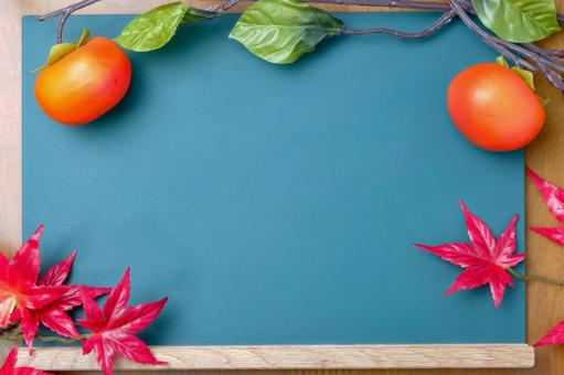 Blackboard frame of persimmon and autumn leaves