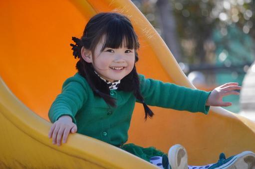 Children playing slide