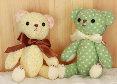Yellow and green teddy bear