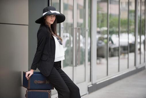 Female sitting in luggage 4