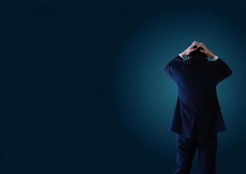 Worried businessman black background