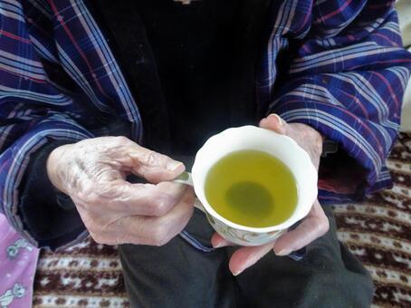 Old man drinking tea