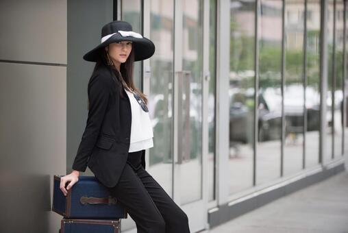 Female sitting in luggage 5