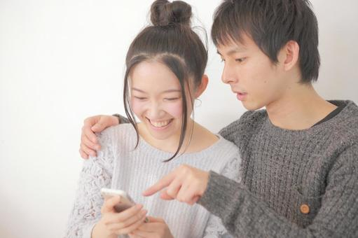 A couple looking at a smartphone