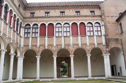 The streets of Bologna White pillar arcade
