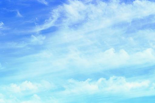 Beautiful sky with delicate white clouds drawing the wind