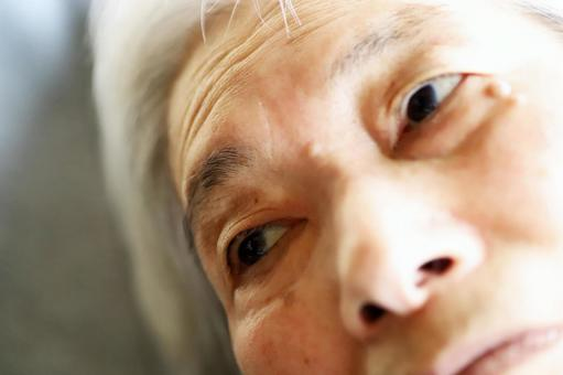 Close-up of the face of a senior woman lying in a nursing bed