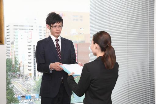 Businessman handing the document 1