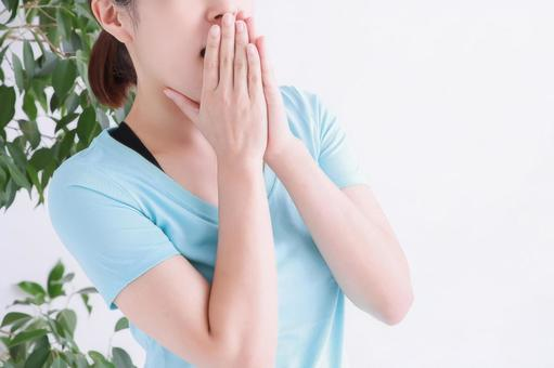 A woman putting her hand on her mouth