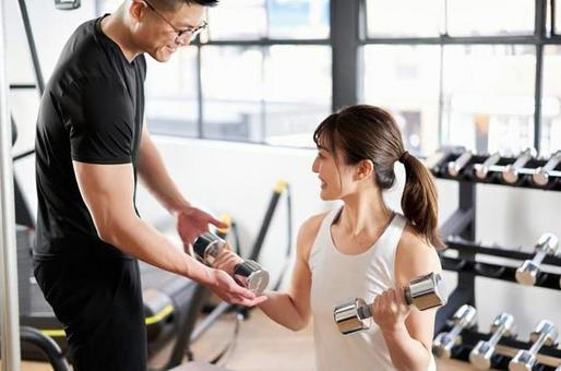 Asian male trainer teaching dumbbell training