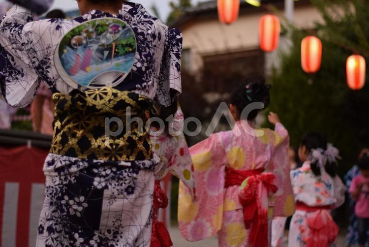 Women and girls wearing Yukata and dancing. Bon Odori