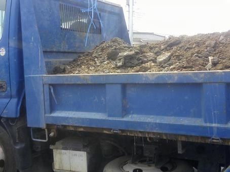 A truck loaded with soil