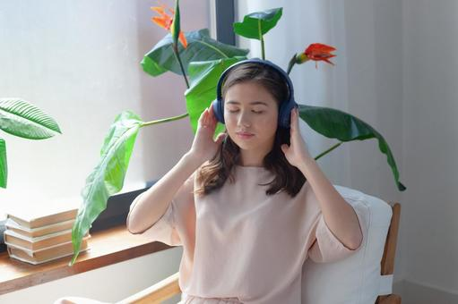 A woman listening to music and meditating