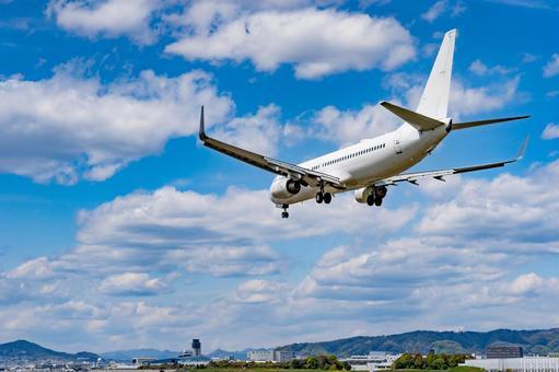 Airplane 40 landing licking behind blue sky