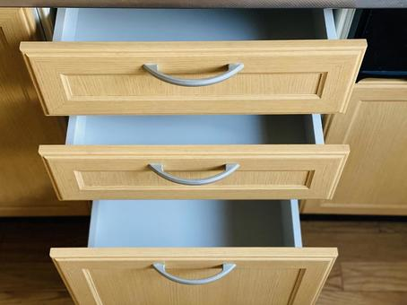 Three empty drawers in the kitchen
