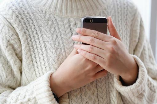 A person holding a smartphone with both hands 1