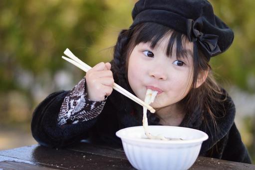 Children eating zoni
