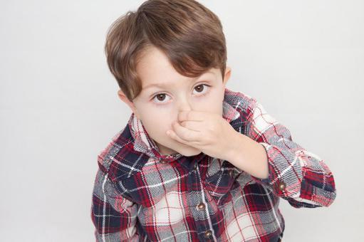 A boy picking his nose 1