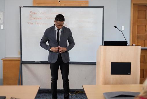 Black men giving a lecture 1