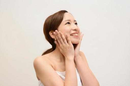 A woman who rejoices when her skin condition is good