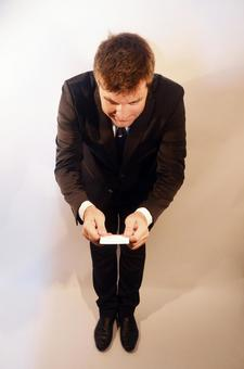 Business card exchange foreign businessman while bowing