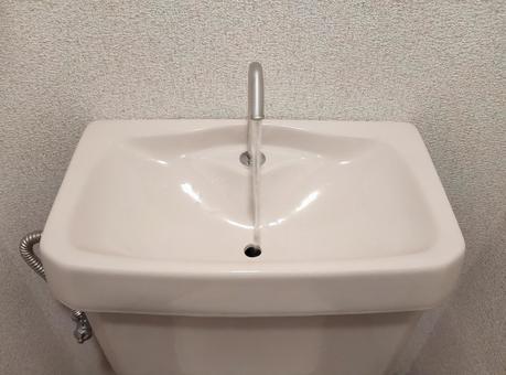 Toilet tank hand washer