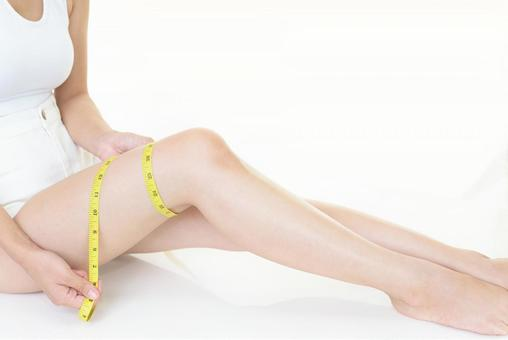 Woman measuring thighs