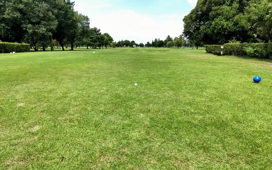 Tee shot at a riverbed golf course