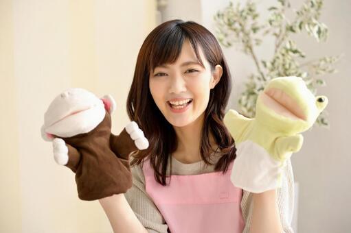 Nursery teacher with puppet