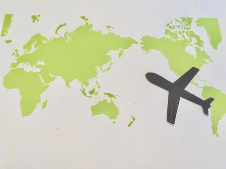 World map and airplane image