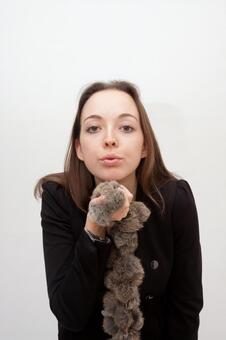 A woman breathing while holding a fur's neck 2