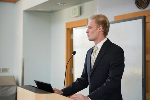 White male speaking 7
