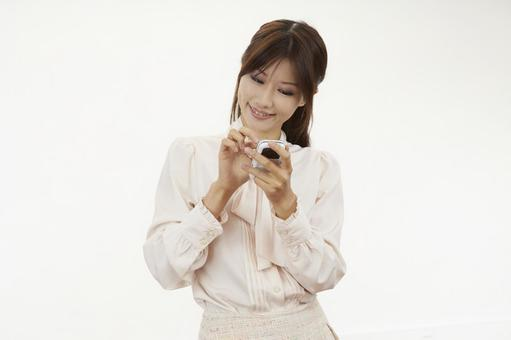 A woman holding a mobile phone 20