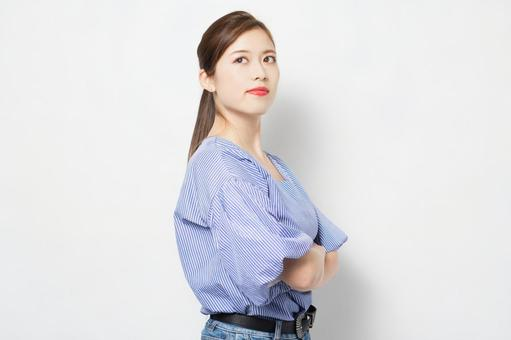 A young woman arms folded