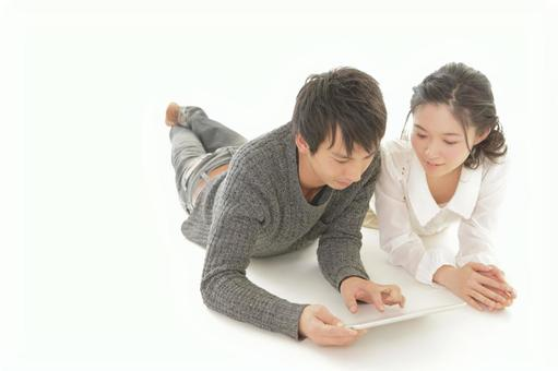 A couple watching a tablet