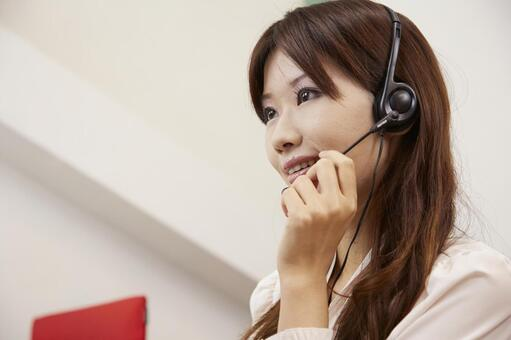 A woman working with a headset 27