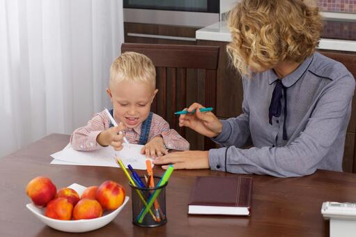 Working mother who holds a son's drawing opponent at the table 1