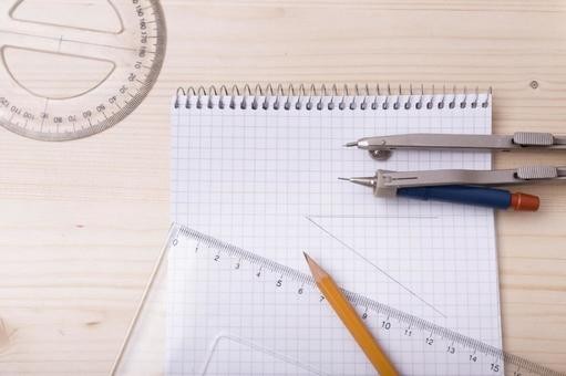 Pencil and protractor, triangular ruler, compass and note