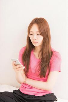 A woman using a smartphone 1
